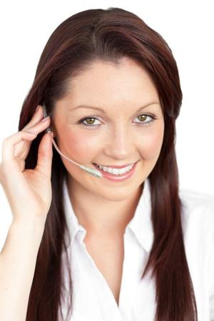 Merry young businesswoman wearing headphones photo