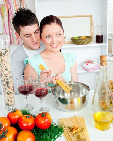 Close couple preparing spaghetti in the kitchen and drinkng wine Stock Photo - 10133607