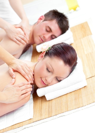 couples therapy: Attractive young couple receiving a back massage