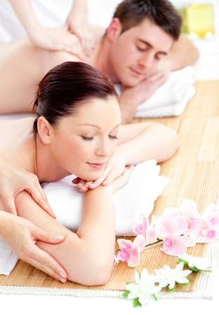 Kind young couple receiving a back massage photo