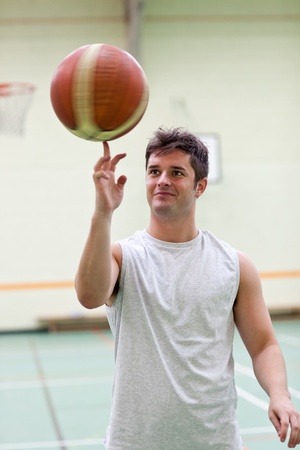 Talented man playing basketball photo