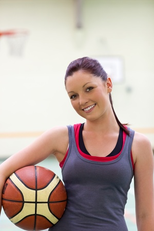 sportswoman: Young woman practicing basketball