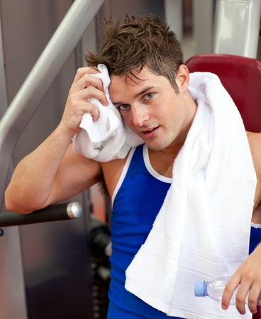 Young man using a bench press Stock Photo - 10133261