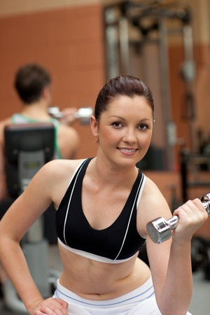 Portrait of an attractive woman working out with dumbbells Stock Photo - 10133161