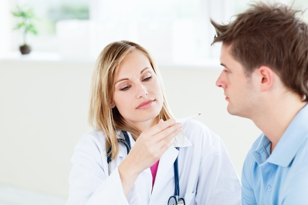 Concentrated female doctor looking at patient photo
