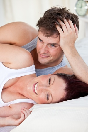 Portrait of a laughing pregnant woman lying on the bed with her husband Stock Photo - 10133669