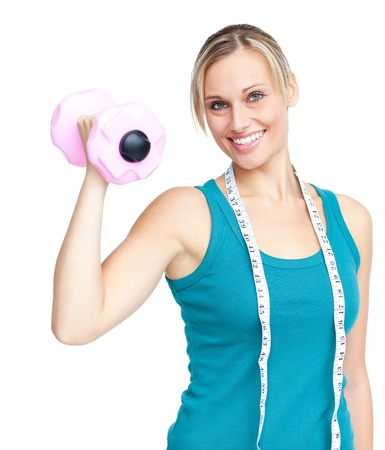 musculation: Young woman holding a dumbbell