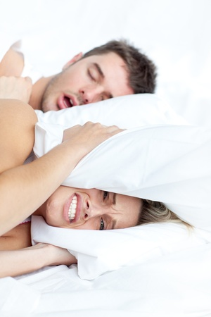 woman cannot stand her partner snoring Stock Photo - 10130542