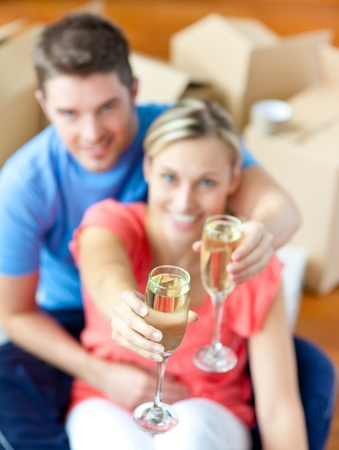 first time buyer: Young couple sitting on the floor in flat