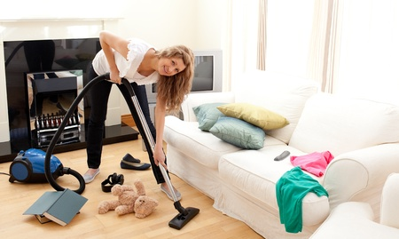 Enthusiastic woman in her chaotic living room Stock Photo - 10163652