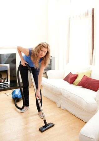 glum: Unhappy woman with vaccum cleaner Stock Photo