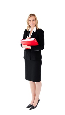 Smiling businesswoman holding a folder against white background photo