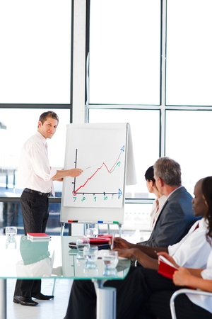 Charismatic businessman doing a presentation  Stock Photo - 10162292