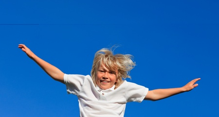 Happy Kid Jumping in the air outdoor  photo