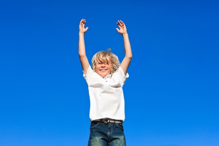 Positive Kid Jumping in the air outdoor  photo