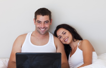 Young couple with laptop photo