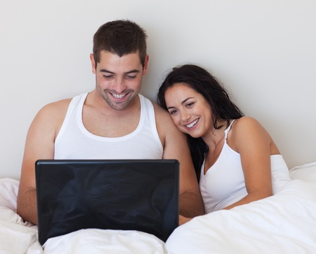 Husband and wife lying in bed  photo
