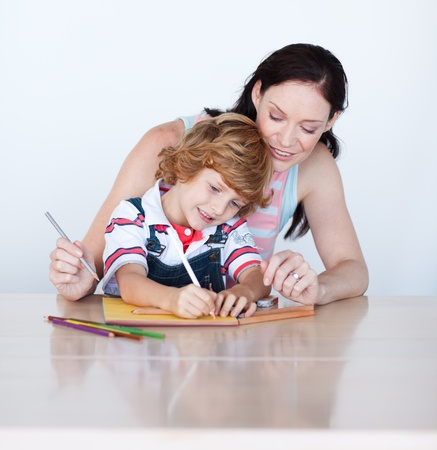 Mother helping her son to draw Stock Photo - 10137132
