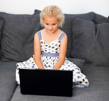 Cute girl with a laptop photo