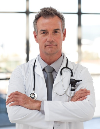 male arm: Serious senior doctor  Stock Photo