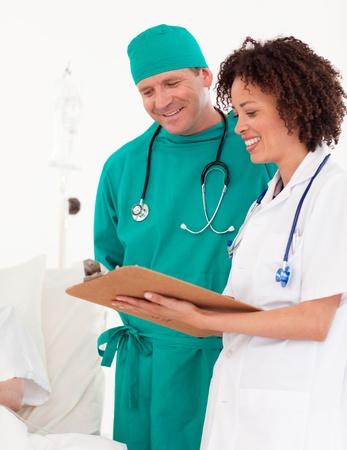 Nice female doctor with surgeon  photo