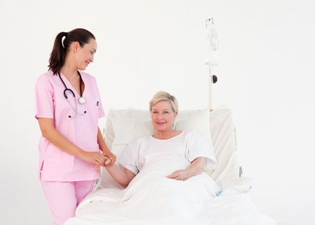 Young attractive nurse with an elderly nice patient  photo