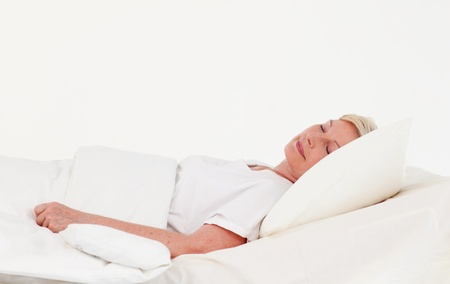 parkinsons: Patient recovering in bed  Stock Photo