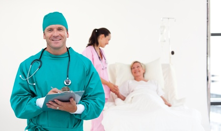 Attractive surgeon with a clip board photo