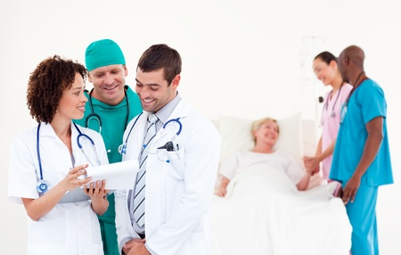 Doctors, surgeon and nurse with a patient photo