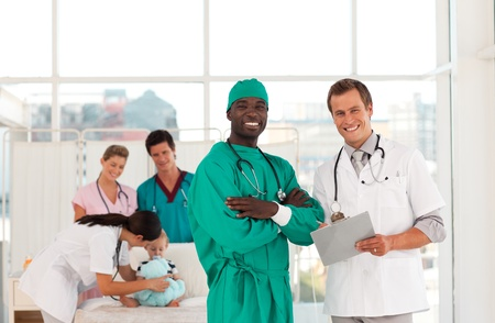 teaming: Surgeon and doctor with medical team