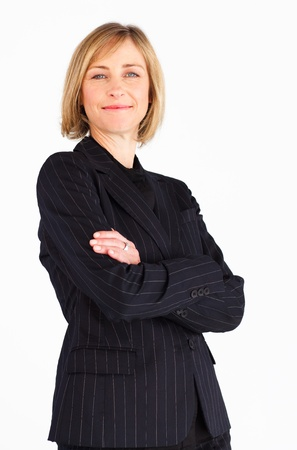 folded arms: Smiling female businessmanager smiling at the camera Stock Photo