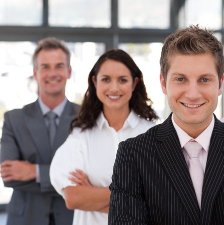 buisinessman: Smiling business team looking at the camera Stock Photo