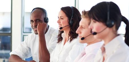 Portrait of a professional multi-ethnic sale representative team at work  Stock Photo - 10135087