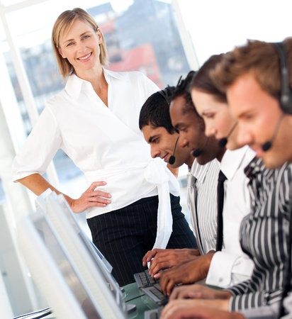 Blond female manager leading her representative team  Stock Photo - 10135101