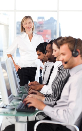 Cheerful female manager leading her representative team Stock Photo - 10136543