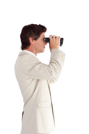 Young businessman with binoculars  photo