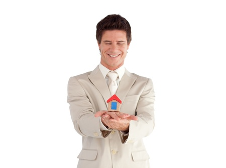 Attractive young businessman presenting a sample of house  Stock Photo - 10196459