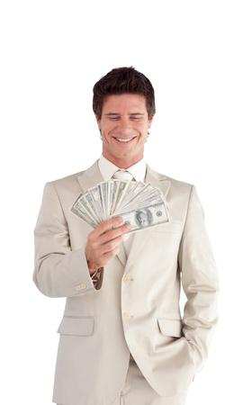 Confident Businessman holding Dollars Stock Photo - 10136356