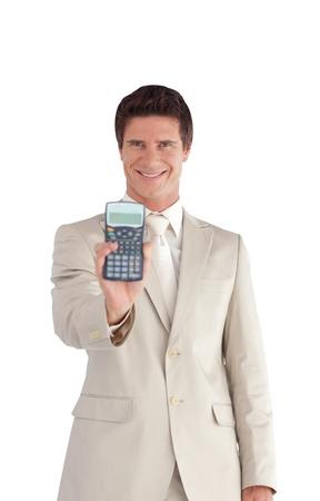 Happy Businessman showing a calculator  photo