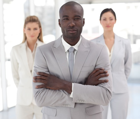 Self-assured afro-american manager with his team  Stock Photo