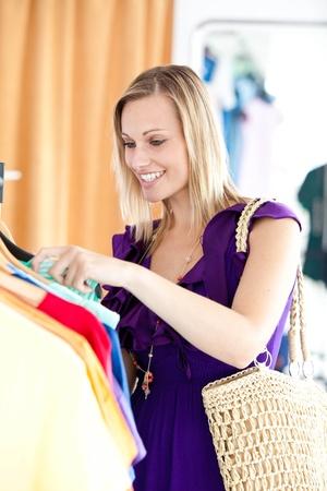 Caucasian woman is doing shopping  photo