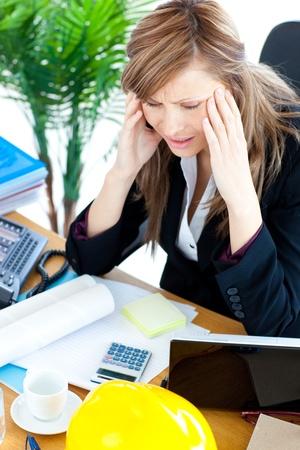 stressed woman:  Stressed businesswoman having a headache