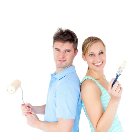 Charming couple smiling at the camera against white background Stock Photo - 10136531