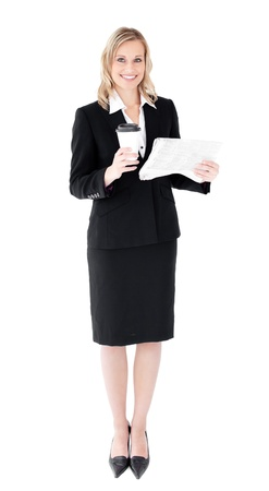 A beautiful businesswoman holding a cup of coffee reading a newspaper against white background Stock Photo - 10134794