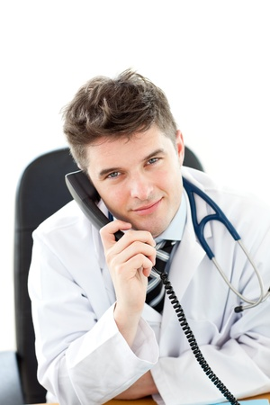 Handsome male doctor talking on the phone in his office Stock Photo - 10162718