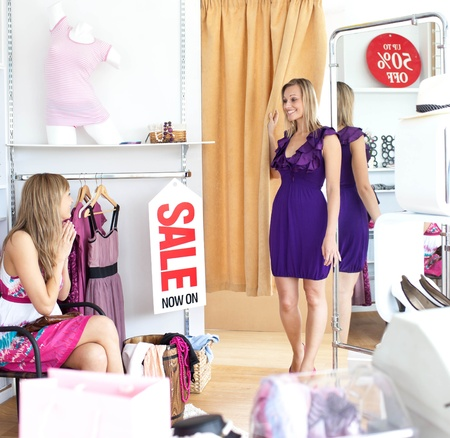 dressing room: Cheerful women choosing clothes together