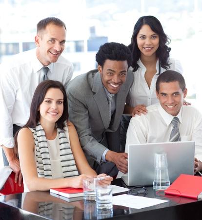 Multi-ethnic business team working together in office photo