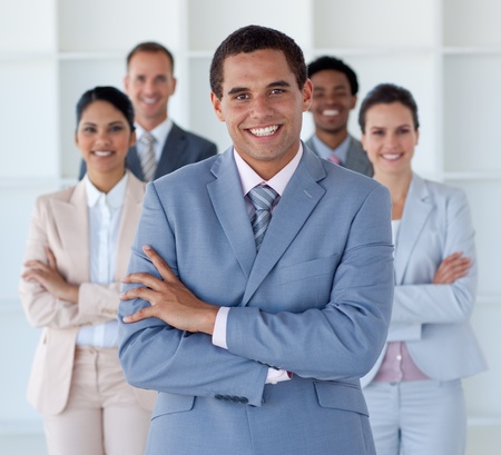 Smiling businessman leading his team Stock Photo - 10137087