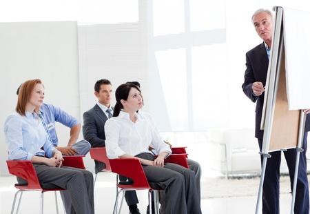 training group: Multi-ethnic business people at a seminar  Stock Photo