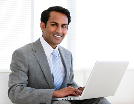 businessman working at his computer: Confident businessman working on his computer